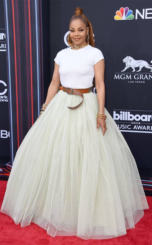 afcbf43944 Here is Janet on the red carpet. I love this combo. A simple white tee,  long tulle skirt and accessorized with gold earrings and necklace. Less is  more!